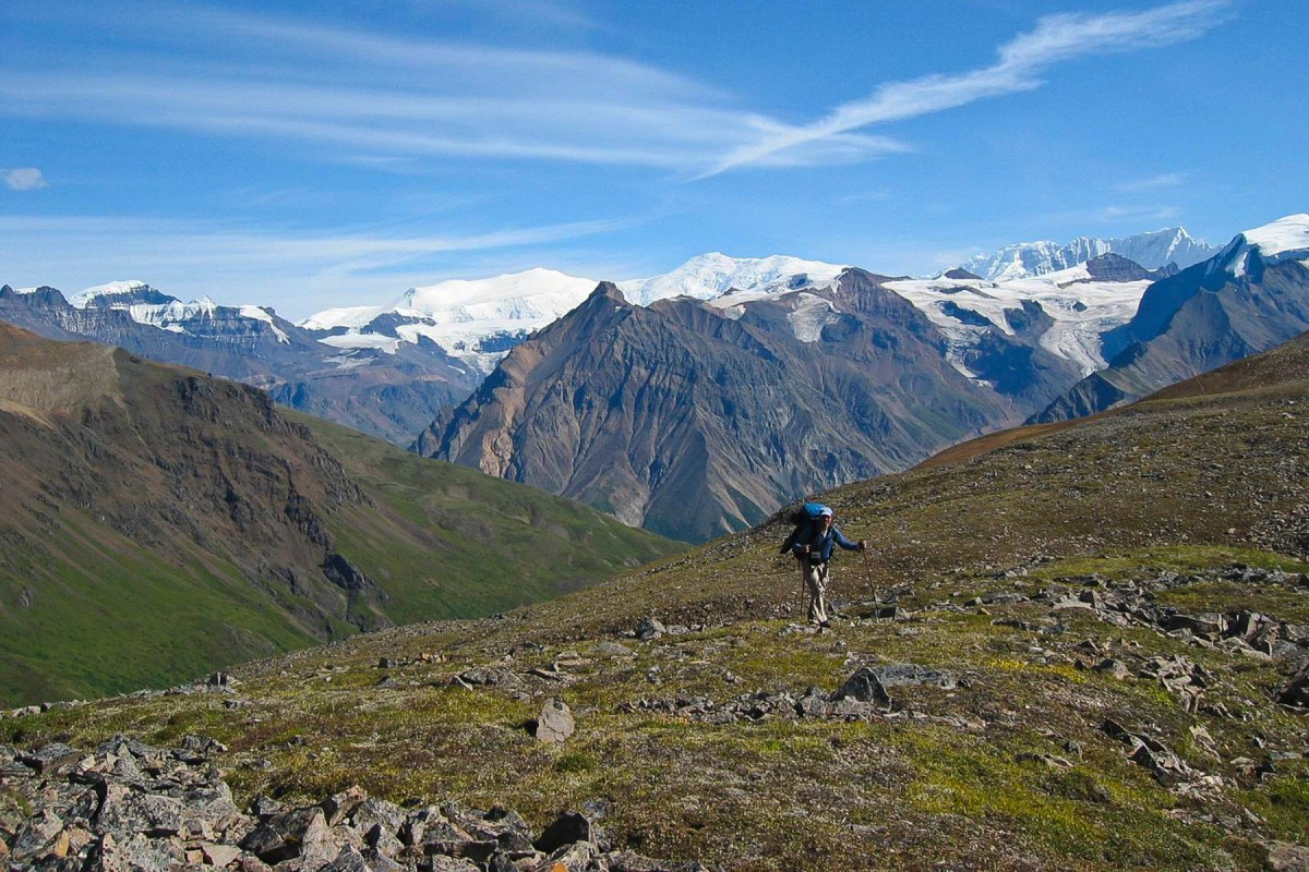 A backpacker hikes The Goat Trail in Wrangell-St. Elias National Park, Alaska.