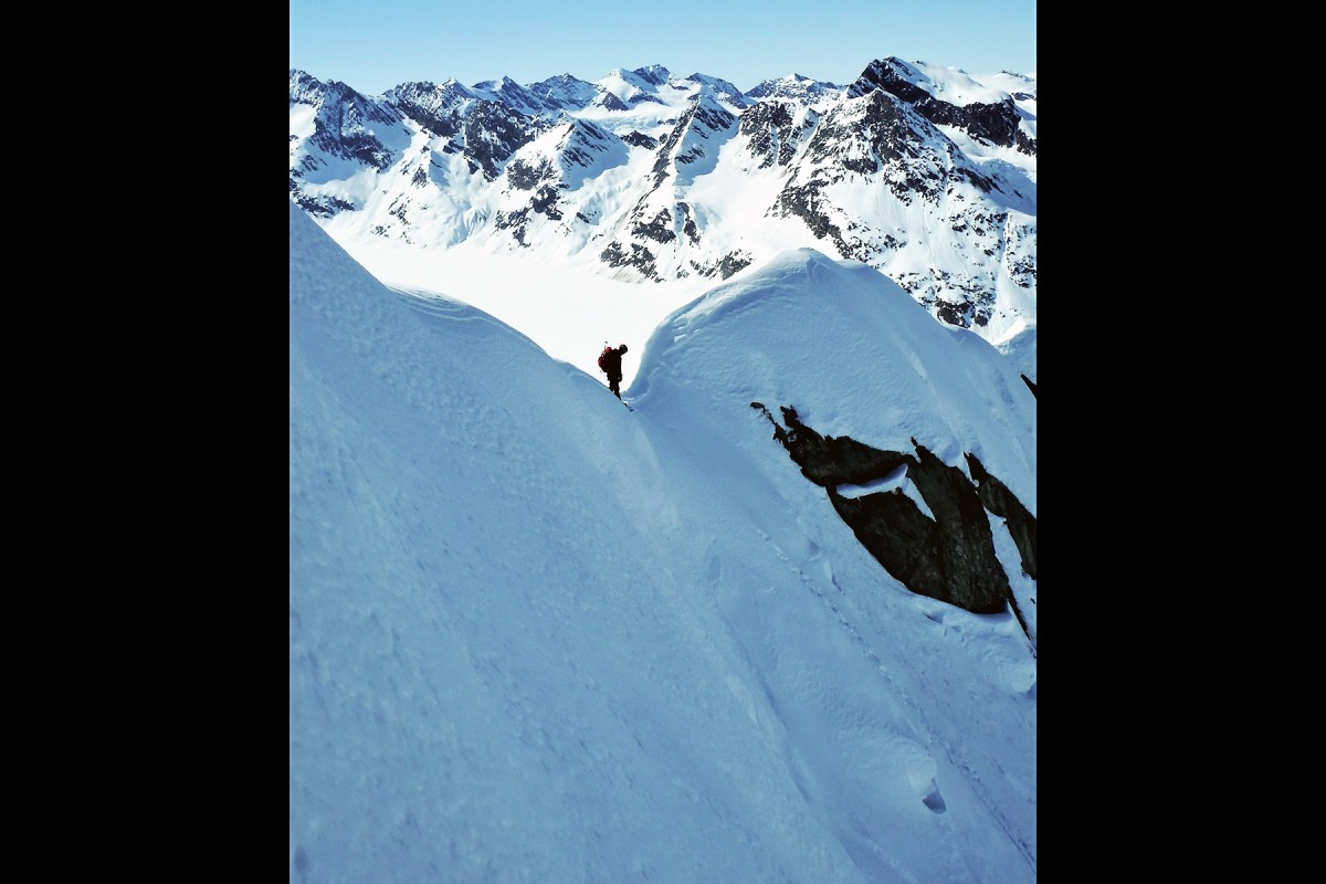 About to drop in, snowboarding the Chugach Mountains out of Valdez, doing a glacier ski camp.