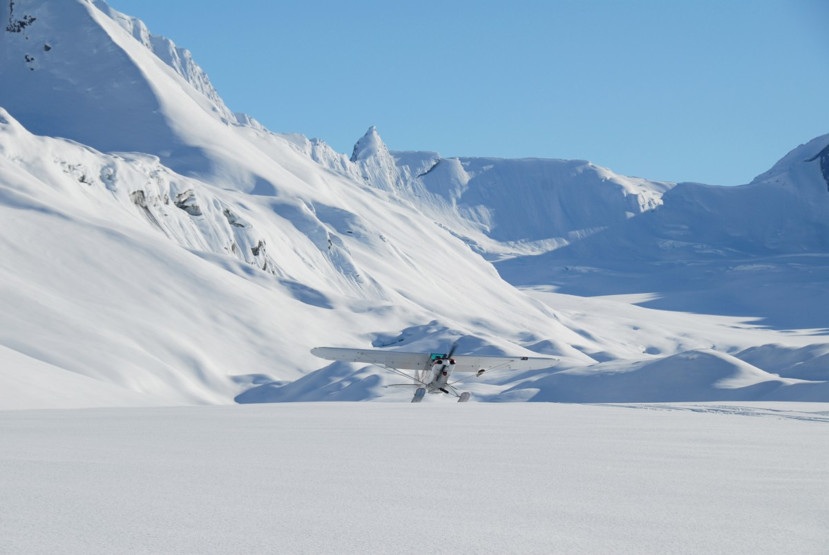 The ski plane taking off at Tasnuna Glacier, post a glacier ski camp drop off.